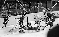Toronto Maple Leafs score against the California Golden  Seals, Leafs Lanny McDonald, Inge Hammarstrom,and Darryl Sittler score against Seal goalie Gilles Meloche, and Marshall Johnston. (1974 photo/Ron Riesterer)