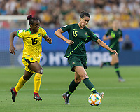 GRENOBLE, FRANCE - JUNE 18: Emily Gielnik #15 of the Australian National Team passes the ball as Tiffany Cameron #15 of the Jamaican National Team pressures during a game between Jamaica and Australia at Stade des Alpes on June 18, 2019 in Grenoble, France.