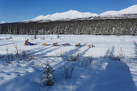 Joan Kljeka and team run down the trail on the Denali Highway with the Alaska Range in the background during the start day of the 2015 Junior Iditarod on Sunday March 1, 2015<br /> <br /> <br /> <br /> (C) Jeff Schultz/SchultzPhoto.com - ALL RIGHTS RESERVED<br />  DUPLICATION  PROHIBITED  WITHOUT  PERMISSION