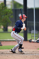GCL Nationals first baseman Blake Chisolm (17) follows through on a swing during a game against the GCL Astros on August 6, 2018 at FITTEAM Ballpark of the Palm Beaches in West Palm Beach, Florida.  GCL Astros defeated GCL Nationals 3-0.  (Mike Janes/Four Seam Images)