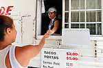 Elodia Saenz cooks and serves at The Taco Truck at 13th and Market Street almost everyday. Harrisburg residents of all ages and races come to The Taco Truck for delicious, authentic Mexican tacos and beverages. JUSTIN A. SHAW/The Patriot-News