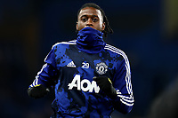 30th October 2019; Stamford Bridge, London, England; English Football League Cup, Carabao Cup, Chelsea Football Club versus Manchester United; Aaron Wan-Bissaka of Manchester Utd wears a snoot during the warm up - Strictly Editorial Use Only. No use with unauthorized audio, video, data, fixture lists, club/league logos or 'live' services. Online in-match use limited to 120 images, no video emulation. No use in betting, games or single club/league/player publications