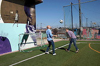 Khayelitsha, South Africa March 5, 2013: Amandla EduFootball founders  <br /> Jakob Schlichtig and Florian Zech play on the field in Khayelitsha a poor township outside Cape Town, South Africa. They use football to initiate, support educational projects for youth in the township. The program keep children busy and it decreases the risk of them joining gang, criminal activity or teenage pregnancy. The crime level has decreased substantially in the area since the program was created in 2006. (Photo by: Per-Anders Pettersson)