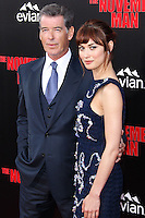 HOLLYWOOD, LOS ANGELES, CA, USA - AUGUST 13: Pierce Brosnan, Olga Kurylenko at the World Premiere Of Relativity Media's 'The November Man' held at the TCL Chinese Theatre on August 13, 2014 in Hollywood, Los Angeles, California, United States. (Photo by Xavier Collin/Celebrity Monitor)
