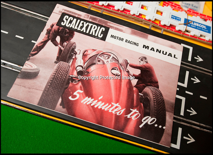 BNPS.co.uk (01202 558833)<br /> Pic: PhilYeomans/BNPS<br /> <br /> Instruction's for the original Scalextric.<br /> <br /> Blast from the past - 56 year old box of the very first Scalextric finally handed over to inventors daughters.<br /> <br /> The dying wish of Scalextric inventor Freddie Francis has been granted - after his daughters were gifted an original mint set that has been in storage for the past 50 years.<br /> <br /> Freddie and his widow Diane boxed up the original set shortly before he died in 1998 and Diana has waited till now before handing the valuable heirloom over.<br /> <br /> The previously unopened set has been preserved in a wooden box at the Francis family home until now.<br /> <br /> The historic set contains 1950's Ferrari and Maserati style racing car's that would have been driven by Fangio and Stirling Moss and even includes oil to keep the cars running and silicone for 'skid patches'.<br /> <br /> Although the set cost £5 in 1957, it's worth well over £1500 today.