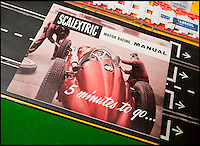 BNPS.co.uk (01202 558833)<br /> Pic: PhilYeomans/BNPS<br /> <br /> Instruction's for the original Scalextric.<br /> <br /> Blast from the past - 56 year old box of the very first Scalextric finally handed over to inventors daughters.<br /> <br /> The dying wish of Scalextric inventor Freddie Francis has been granted - after his daughters were gifted an original mint set that has been in storage for the past 50 years.<br /> <br /> Freddie and his widow Diane boxed up the original set shortly before he died in 1998 and Diana has waited till now before handing the valuable heirloom over.<br /> <br /> The previously unopened set has been preserved in a wooden box at the Francis family home until now.<br /> <br /> The historic set contains 1950's Ferrari and Maserati style racing car's that would have been driven by Fangio and Stirling Moss and even includes oil to keep the cars running and silicone for 'skid patches'.<br /> <br /> Although the set cost &pound;5 in 1957, it's worth well over &pound;1500 today.