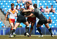 PICTURE BY VAUGHN RIDLEY/SWPIX.COM - Rugby League - Super League Magic Weekend - Catalans Dragons v London Broncos - Eithad Stadium, Manchester, England - 27/05/12 - Catalans Lopini Paea drives through the London defence.