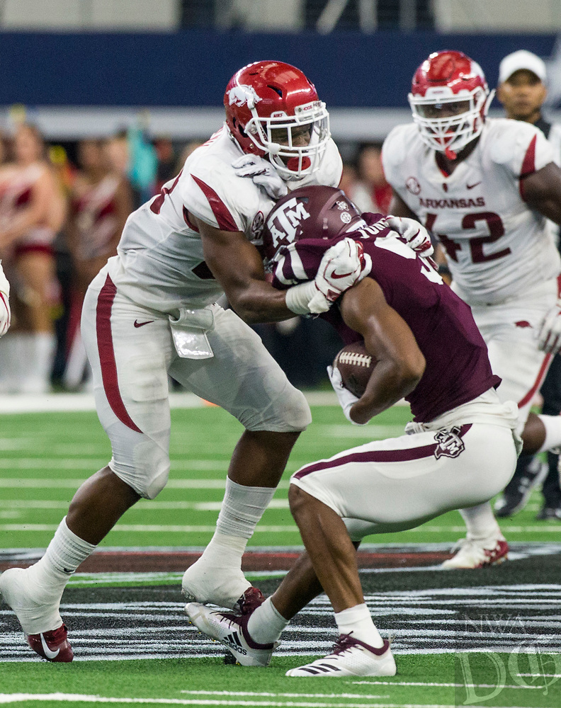 Hawgs Illustrated/Ben Goff<br /> Dre Greenlaw, Arkansas linebacker, tackles Hezekiah Jones, Texas A&M wide receiver, in the 2nd quarter Saturday, Sept. 29, 2018, during the Southwest Classic at AT&T Stadium in Arlington, Texas.