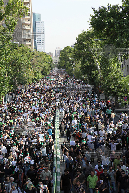 Silent protest. An estimated one million people form a human chain along Vali asr Avenue, the longest street in Tehran. Following a disputed election result, thousands of supporters of opposition candidate Mir-Hossein Mousavi took to the streets in protest.