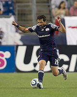 New England Revolution midfielder Monsef Zerka (19) brings the ball forward. In a Major League Soccer (MLS) match, the New England Revolution defeated FC Dallas, 2-0, at Gillette Stadium on September 10, 2011.