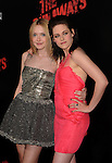 HOLLYWOOD, CA. - March 11: Dakota Fanning and Kristen Stewart arrive at the Los Angeles Premiere of The Runaways at ArcLight Cinemas Cinerama Dome on March 11, 2010 in Hollywood, California.