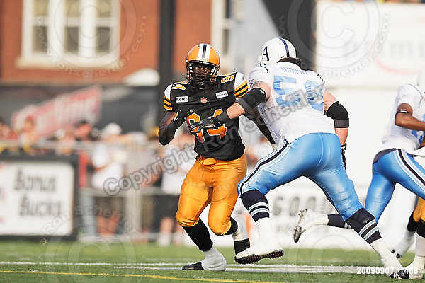 September 7, 2009; Hamilton, ON, CAN; Hamilton Tiger-Cats defensive lineman Khari Long (94) vs. Toronto Argonauts tackle Rob Murphy (56). CFL football - the Labour Day Classic - Toronto Argonauts vs. Hamilton Tiger-Cats at Ivor Wynne Stadium. The Tiger-Cats defeated the Argos 34-15. Mandatory Credit: Ron Scheffler.