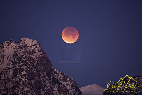 Eclipsing moon settin into Death Canyon in the Grand Tetons