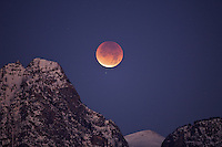 """Full eclipse of the Moon over Death Canyon in Grand Teton National Park.<br /> <br /> For production prints or stock photos click the Purchase Print/License Photo Button in upper Right; for Fine Art """"Custom Prints"""" contact Daryl - 208-709-3250 or dh@greater-yellowstone.com"""