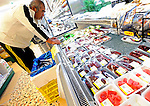 A man looks at the dolphin meat and other sashimi products at a supermarket in Taiji, Japan on 10 September 2009. A small 250 gram block of short fin dolphin meat sells for around 1,200 yen (US$13.20) at the supermarket..Photographer: Robert Gilhooly...