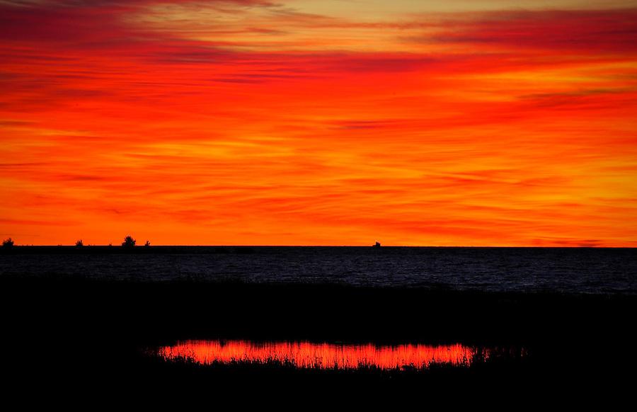 Sun rises over Newport State Park, Door County Wisconsin.