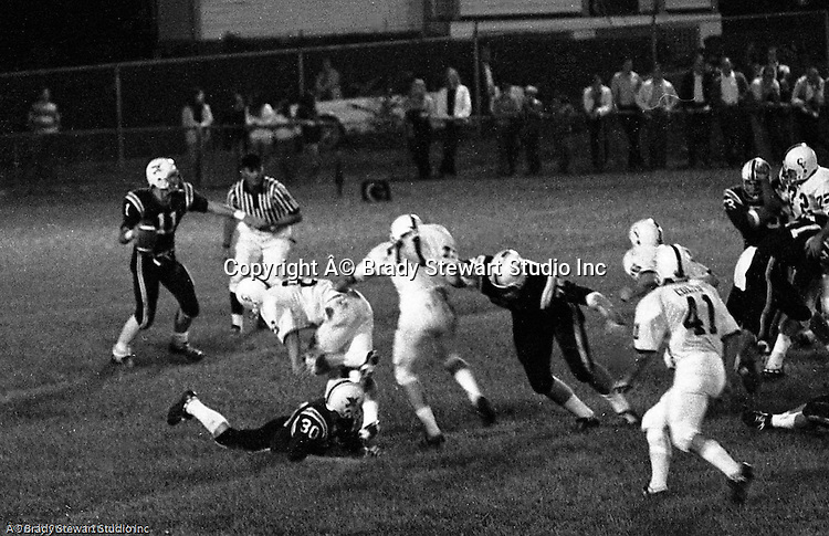 "Bethel Park PA:  Offensive play with Mike Stewart 11 trying to complete a pass to Bruce Evanovich 80.  Mike didn't get much help with the three ""look out"" blocks from Clark Miller 30, Joe Barrett 75, and Dennis Franks 66. Others in the photo; Jim Dingeldine 73.  The Bethel Park defense played very well in the 13-6 win at Chartiers Valley Stadium. The game went down to the last play of the game when Mike Stewart threw a 65 TD pass to Gary Biro 81.  The defensive unit was one of the best in Bethel Park history only allowing a little over 7 points a game.  The 1970 team had more players winning 4-years scholarships than any other class. Division 1:  Dennis Franks (Michigan), Mike Stewart and Joe Barrett (William & Mary), Scott Streiner and Glenn Eisaman (Cincinnati), Division 2: Jim Dingeldine (West Liberty), Clark Miller (Clarion)."