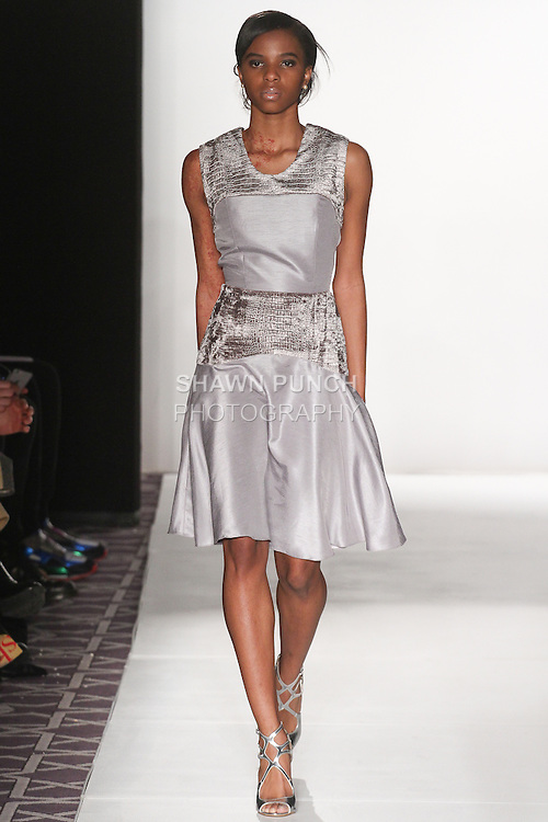 "Model walks runway in an outfit from the Ericka Castaneda Fall Winter 2015 ""Notre Madame"" collection, during the Emerging Designers Fall Winter 2015 fashion show for  Fashion Gallery New York Fashion Week Fall 2015."