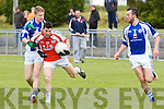 Pictured on Sunday for the Castleisland Mart Junior County Championship Quarter-Final, Brosna V Templenoe in Pairc na Feile Brosna. Brosna's Tom McGoldrick under pressure from Templenoe's Gavin Crowley.