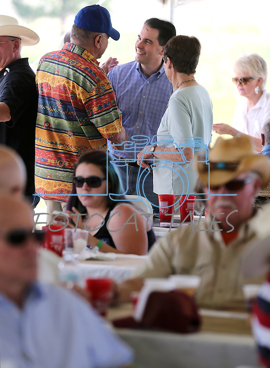 Wisconsin Gov. Scott Walker, center, talks with people in the crowd at the Inaugural Basque Fry in Gardnerville, Nev., on Wednesday, Aug. 12, 2015. Walker was one of a handful of Republican presidential candidates who attended the event.<br /> Photo by Cathleen Allison