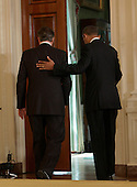 Prime Minister David Cameron of Great Britain is escorted from a news briefing by United States  President Barack Obama, May 13, 2013,  at The White House in Washington, DC. .Credit: Chris Kleponis / CNP