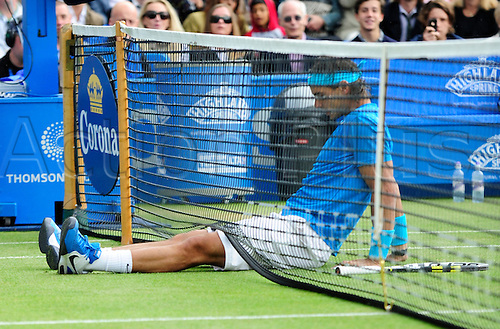 10.06.2011 The AEGON Championships from Queens Club in London. Rafael Nadal of Spain slips and falls in his match against Jo-Wilfried Tsonga of France on day five of the Aegon Championships at the Queen's Club. Sequence shot