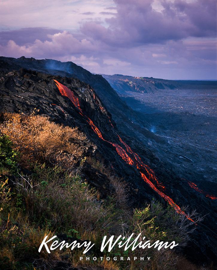 Lava flowing down cliffside, Volcanoes National Park, Big Island, Hawaii, USA.