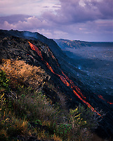 Lava flowing down cliffside, Volcanoes National Park, Big Island, Hawaii, USA.
