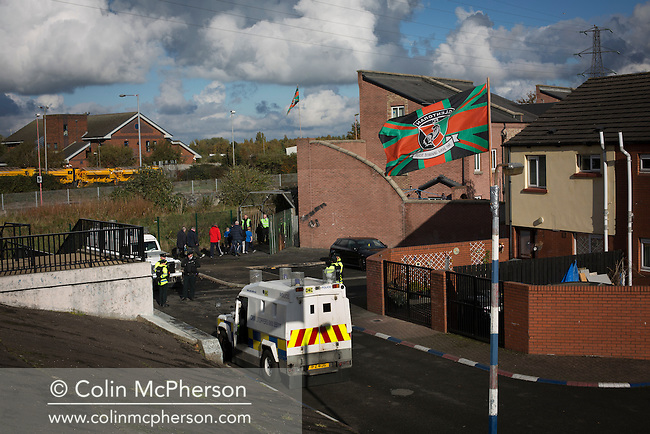 Police Service of Northern Ireland officers on duty as away fans arrive at The Oval, Belfast before Glentoran hosted city-rivals Cliftonville in an NIFL Premiership match. Glentoran, formed in 1892, have been based at The Oval since their formation and are historically one of Northern Ireland's 'big two' football clubs. They had an unprecendentally bad start to the 2016-17 league campaign, but came from behind to win this fixture 2-1, watched by a crowd of 1872.