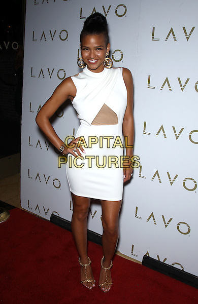 Cassie (Casandra Elizabeth Ventura) .hosts King of Hearts party at Lavo inside The Palazzo Las Vegas, Nevada, USA, 14th July 2012..full length white dress cut out mesh sleeveless  gold sandals hand on hip .CAP/ADM/MJT.© MJT/AdMedia/Capital Pictures.