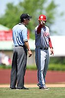 Hagerstown Suns manager Patrick Anderson (15) argues a call with umpire Jeff Gorman during a game against the Lexington Legends on May 19, 2014 at Whitaker Bank Ballpark in Lexington, Kentucky.  Lexington defeated Hagerstown 10-8.  (Mike Janes/Four Seam Images)