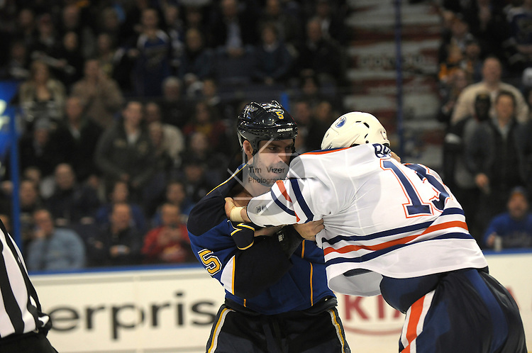 Edmonton Oilers right wing Mike Brown (13) and St. Louis Blues defenseman Barret Jackman (5) fight late in the second period during a game between the Edmonton Oilers and the St. Louis Blues on Tuesday March 26, 2013 at the Scottrade Center in downtown St. Louis.