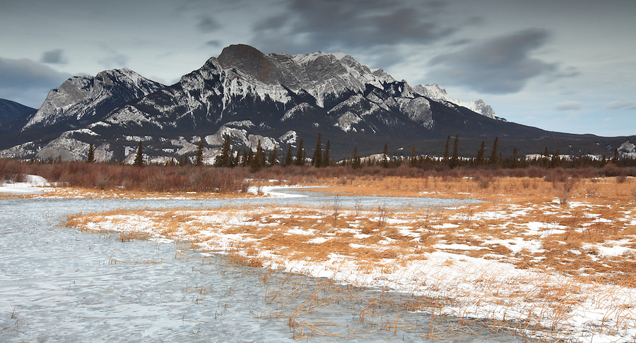 Water is frozen into the shape of small ripples due to high wind on this frozen lake in Jasper National Park, Alberta, Canada.