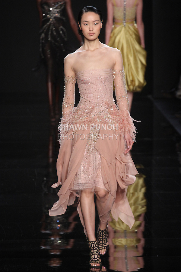 "Model walks runway in a blush embroidered dress with silk chiffon cascade skirt and lace underpinning from the Reem Acra Fall 2016 ""The Secret World of The Femme Fatale"" collection, at NYFW: The Shows Fall 2016, during New York Fashion Week Fall 2016."