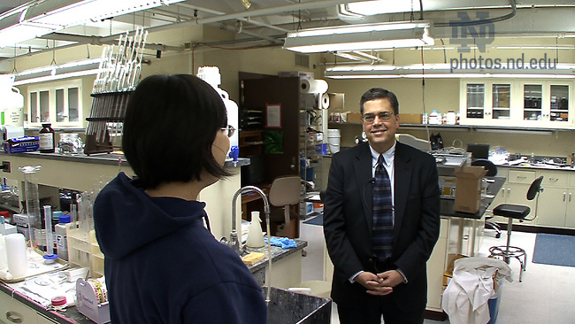 Engineering Dean Peter Kilpatrick talks with a student in a Fitzpatrick Hall lab.  Still image taken from Video.