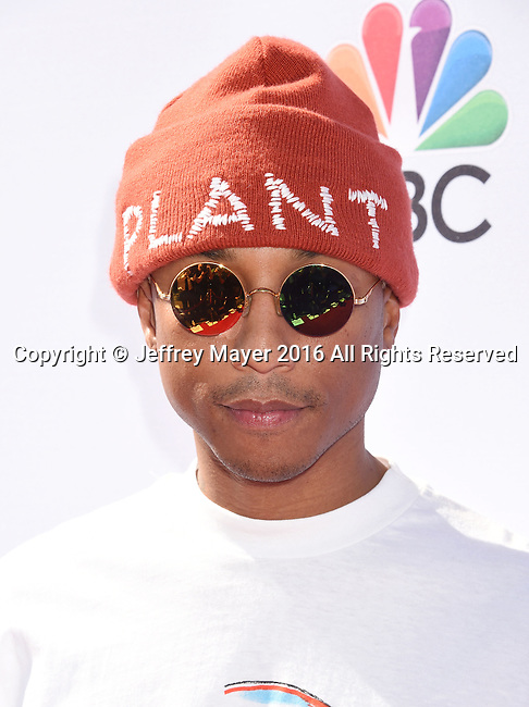 WEST HOLLYWOOD, CA - APRIL 21: Singer/musician Pharrell Williams arrives at 'The Voice' Karaoke For Charity event at HYDE Sunset: Kitchen + Cocktails on April 21, 2016 in West Hollywood, California.