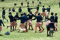 Kenya. Rift Valley Province. Nyahururu. Nyandarva boarding primary school. At break time, the pupils play games on the grass. The boys and girls wear a colorful uniform. © 2004 Didier Ruef