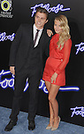 "WESTWOOD, CA - OCTOBER 03: Actors Kenny Wormald and Julianne Hough attend the ""Footloose"" Los Angeles Premiere at Regency Village Theatre on October 3, 2011 in Westwood, California."