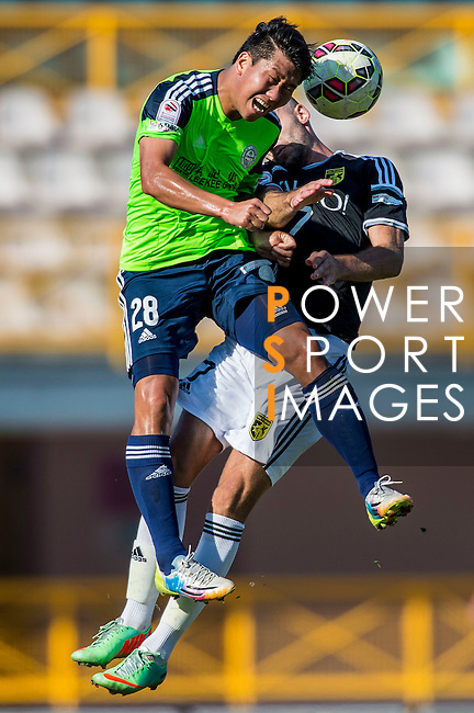 Haopeng Wu of Wofoo Tai Po (L) competes for the ball with Petrisor Voinea of Sun Pegasus FC (R) during the HKFA Premier League between Wofoo Tai Po vs Sun Pegasus at the Tai Po Sports Ground on 22 November 2014 in Hong Kong, China. Photo by Aitor Alcalde / Power Sport Images