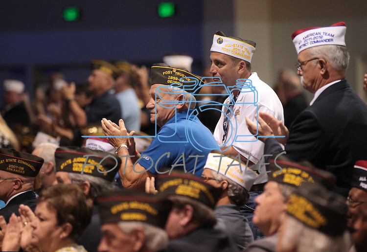 Participants applaud Republican presidential candidate Mitt Romney during his speech at the Veterans of Foreign Wars convention in Reno, Nev., on Tuesday, July 24, 2012..Photo by Cathleen Allison