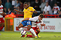 Robbie Rogers of Stevenage grapples with Jason Puncheon of Southampton. Stevenage v Southampton - Capital One Cup Second Round - Lamex Stadium, Stevenage - 28th August, 2012. © Kevin Coleman 2012