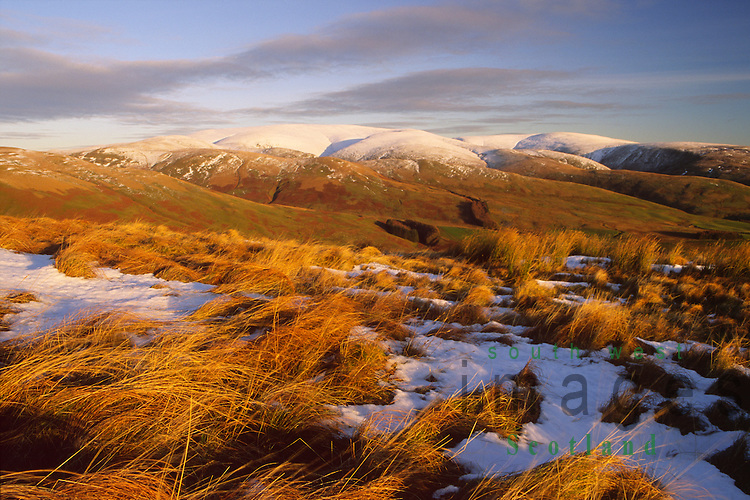 Winter landscape near sunset looking across the Devils Beef Tub to Hart Fell in the snow topped Moffat Hills Dumfries and Galloway Scotland UK