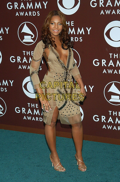 ASHANTI.47th Annual Grammy Awards - Arrivals. Los Angeles, California .February 13th, 2005.Photo Credit: Jacqui Wong/AdMedia.full length beige brown dress jewel encrusted plunging neckline cleavage sheer.www.capitalpictures.com.sales@capitalpictures.com.© Capital Pictures.