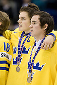 Anton Lander (Sweden - 16), Marcus Johansson (Sweden - 11) - Team Sweden celebrates after defeating Team Switzerland 11-4 to win the bronze medal in the 2010 World Juniors tournament on Tuesday, January 5, 2010, at the Credit Union Centre in Saskatoon, Saskatchewan.