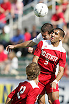 15 November 2009: Virginia's Jordan Evans (behind) and NC State's Romulo Manzano (3). The University of Virginia Cavaliers defeated the North Carolina State University Wolfpack 1-0 at WakeMed Stadium in Cary, North Carolina in the Atlantic Coast Conference Men's Soccer Tournament Championship game.