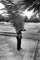 Albania. Tirana. National Martyrs Cemetery. The Orchestra Frymore is the only Albanian military brass band. A military band is a group of personnel that performs musical duties for military functions or official events. A typical military band consists mostly of wind and percussion instruments. The conductor of the band, hidden by a palm tree's branch, bears commonly the title of Bandmaster or Director of Music. The band is playing on National Day at the National Martyrs Cemetery of Albania which is the largest cemetery in Albania, located on a hill overlooking Tirana. Tirana is the capital and largest city of Republic of Albania. 29.11.1998 © 1998 Didier Ruef