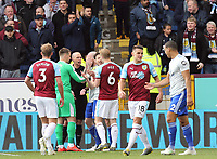 Referee Michael Dean is mobbed by players from both sides after reverting his second half penalty decision<br /> <br /> Photographer Rich Linley/CameraSport<br /> <br /> The Premier League - Saturday 13th April 2019 - Burnley v Cardiff City - Turf Moor - Burnley<br /> <br /> World Copyright © 2019 CameraSport. All rights reserved. 43 Linden Ave. Countesthorpe. Leicester. England. LE8 5PG - Tel: +44 (0) 116 277 4147 - admin@camerasport.com - www.camerasport.com