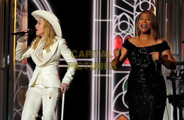 LOS ANGELES, CA - JANUARY 26 : Madonna (L) and Queen Latifah (R) speak onstage at The 56th Annual GRAMMY Awards at Staples Center on January 26, 2014 in Los Angeles, California.<br /> CAP/MPI/PG<br /> &copy;PGFMicelotta/MediaPunch/Capital Pictures