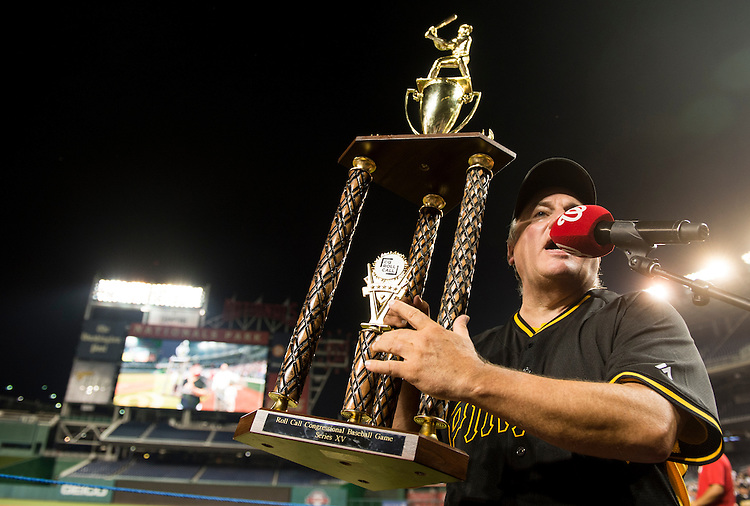 UNITED STATES - JUNE 11: Democrats' manager Rep. Mike Doyle, D-Pa., holds up the trophy after the 54th Annual Roll Call Congressional Baseball Game at Nationals Park in Washington on Thursday, June 11, 2015. The Democrats beat the Republicans 5-2. (Photo By Bill Clark/CQ Roll Call)