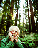 USA, California, Eureka, 103 year old woman laughing in the redwoods in Northern California